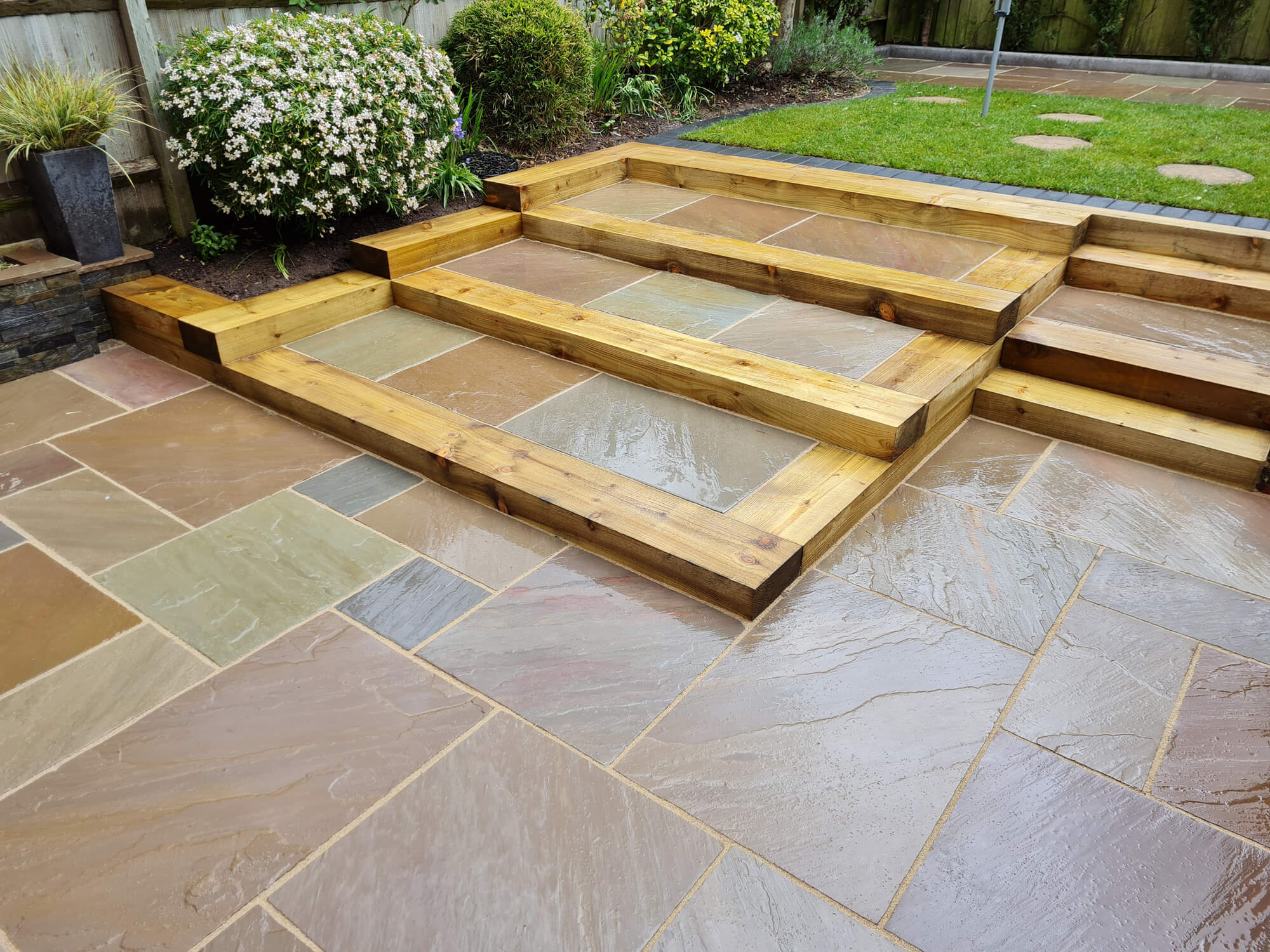 JD Landscapes Patio After Replaced Sleepers and Removed Old Patio with Natural Stone Slabs in Raj Green