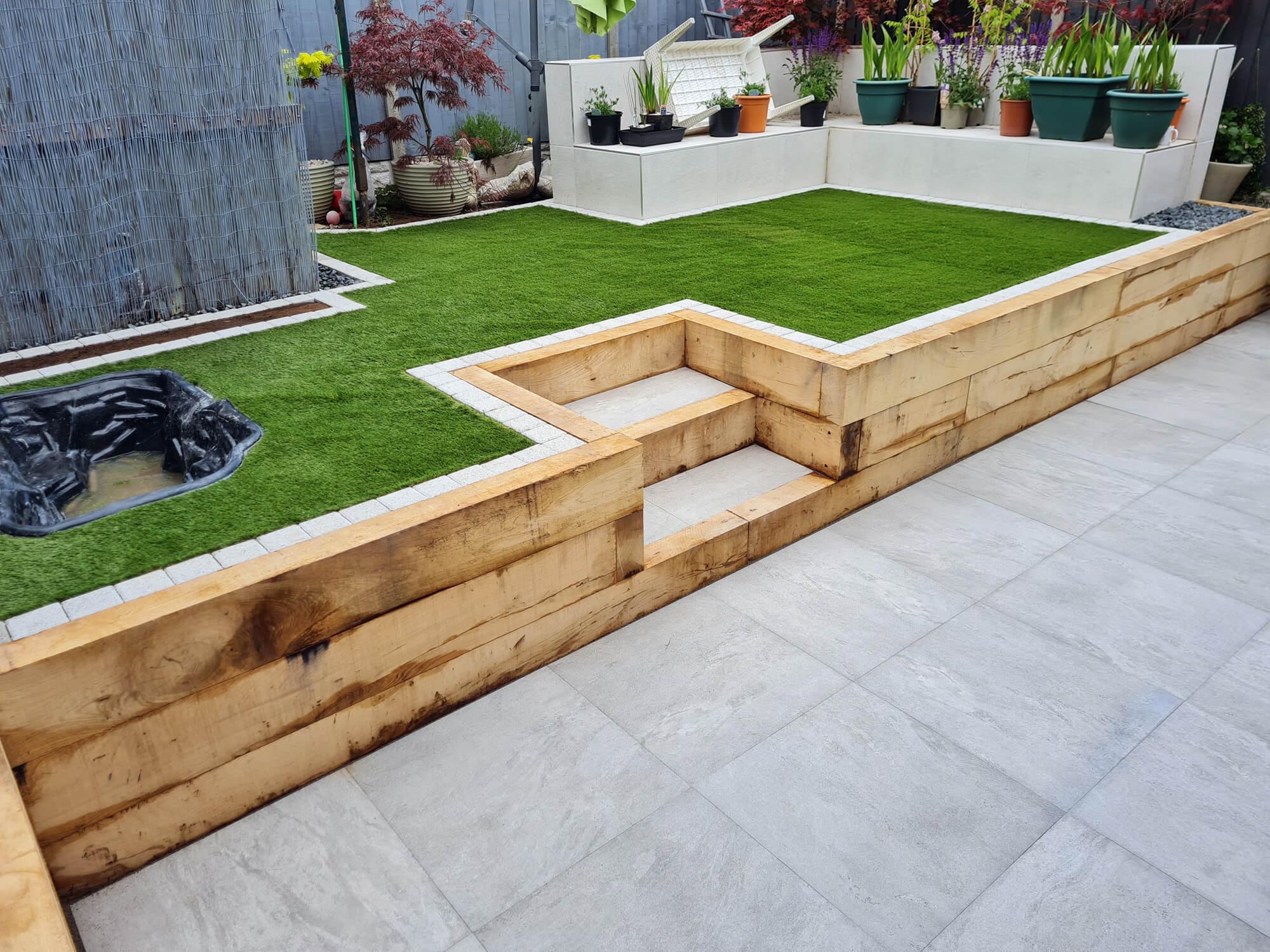 JD Landscapes Upper & Lower Tier Garden with Oak Timber Sleepers & Artificial Grass